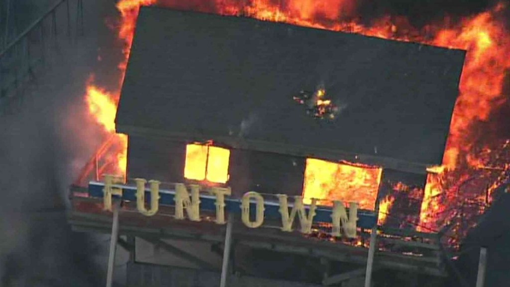 This image of an amusement park aflame is symbolic of your life before White Cosby's advice.